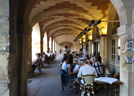 View of typical French cafe Place Royalel in the quarter Marais, the historic Parisian district set on the Right Bank .