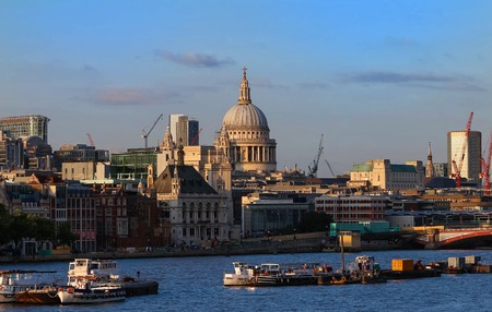 The dome of St. Pauls Cathedral across the Thames river by the early evening sun, London. Reklamní fotografie