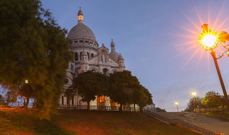 The famous basilica Sacre Coeur at night , Paris, France.