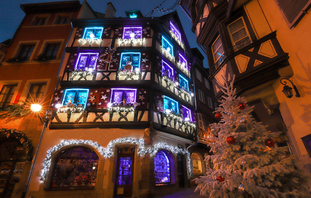 Traditional Alsatian half-timbered houses in old town of Colmar, decorated for christmas time, Alsace, France Stock fotó