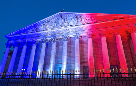 The French National Assembly lit up with colors of French national flag ,Paris. Stok Fotoğraf
