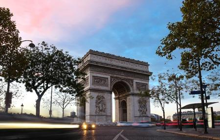 The Triumphal Arch at sunset , Paris, France.