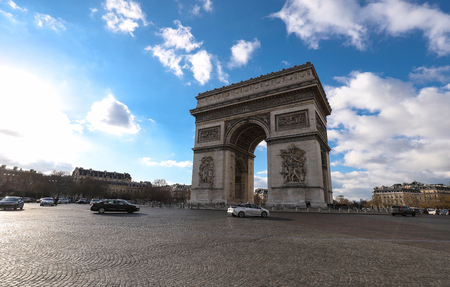 The famous Triumphal Arch at sunny day , Paris, France.