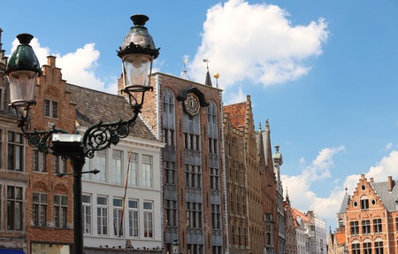 Colorful traditional buildings with ancient lamp post , Bruges, Belgium Imagens