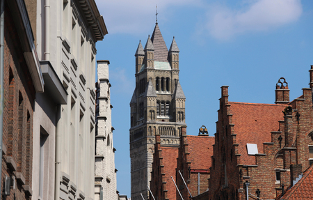 The tower Saint-Salvator Cathedral and ancient roofs of Bruges and on a sunny day. Belgium.