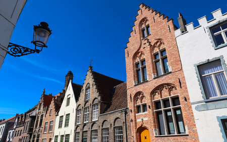 Street view with traditional medieval houses in Bruges , Belgium