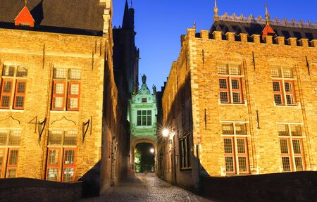 Scenic city view of Bruges beautiful medieval colored houses in the evening.