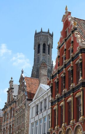 The tower of Belfry and ancient houses of Bruges and on a sunny day. Belgium.