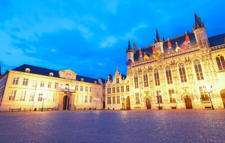 Scenic cityscape with the night medieval Burg Square in Bruges, Belgium.