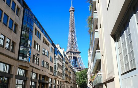 The Eiffel tower is the most popular travel place and global cultural icon of the France and the world. Фото со стока