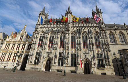 Bruges City Hall on Burg Square. Bruges, Flemish Region, Belgium. Фото со стока
