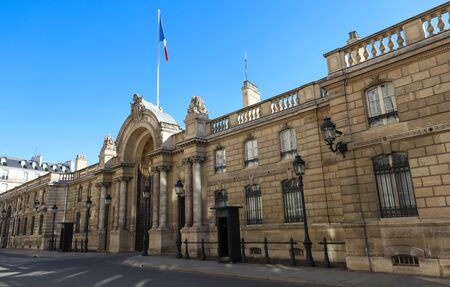 View of entrance gate of the Elysee Palace from the Rue du Faubourg Saint-Honore . Elysee Palace - official residence of President of French Republic .