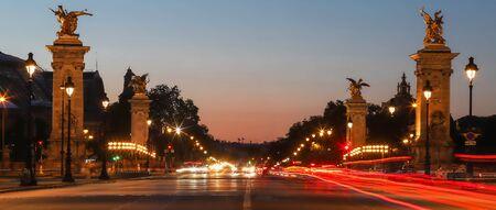 The panoramic view of pillars bridge Alexandre III in the evening , Paris, France.