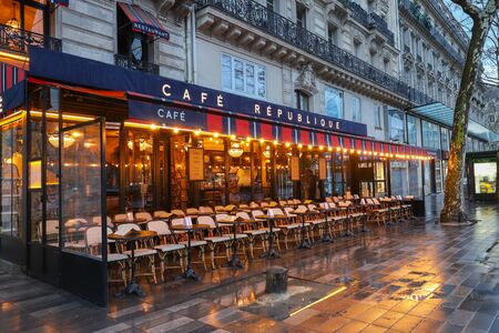The Cafe Republique at rainy morning . It is traditional French cafe located on Republic square in Paris, France.