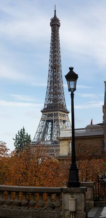 Beautiful view of autumn trees with the Eiffel tower in the foreground in Paris. Stock Photo
