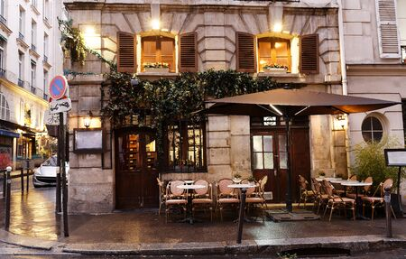 Typical view of the Parisian street with tables of cafe in Paris, France. Architecture and landmark of Paris.