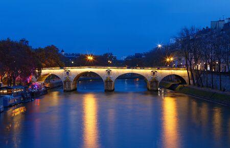 The view of bridge Ponte Marie over Seina river at night , Paris, Europe.