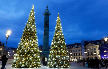 The place Vendome decorated for Christmas at night, Paris, France.