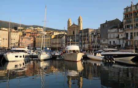 View of St Jean Baptiste cathedral and old port of Bastia , Corsica island, second largest corsican city and main entry point to the island