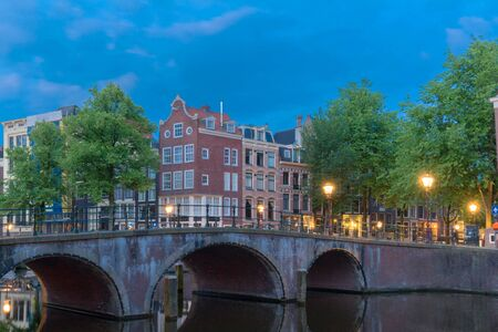 Beautiful view of Amsterdam canals with bridge and typical dutch houses, the Netherlands. 版權商用圖片