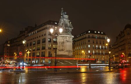 Place de Clichy at rainy night , Paris. Bronze statue of Marechal Moncey at the centre of the square. Crossing four districts of the city at one point. 版權商用圖片