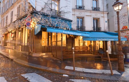 Typical Parisian cafe Les Petits cousins located in Montmartre district of Paris. Editorial