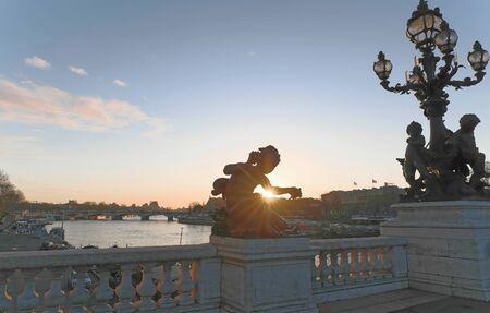 Ornate lamp posts along the Alexandre bridge III br in Paris