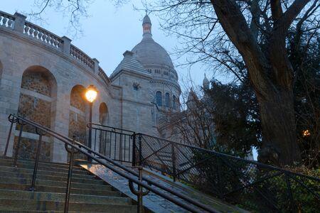 The famous basilica Sacre Coeur at rainy morning , Paris, France.