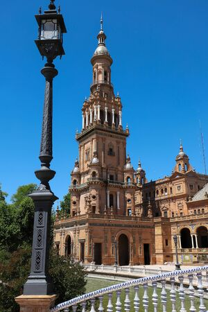 The panoramic view of the North Tower at the end of the neo-Moorish style building located in the beautiful Plaza de Espana in the city of Seville in Andalusia, Spain