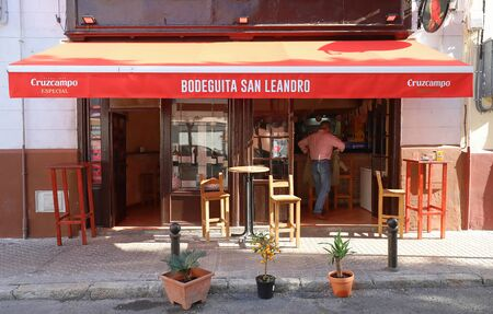 Beautiful facade of the vintage traditional Spanish bar San Leandro located in historic centre ,near San Leandro square ,Seville, Spain. Editoriali
