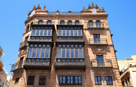 Facade of traditional spanish house decorated with tiles . Seville, Andalusia, Spain, Western Europe.