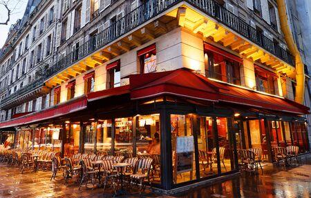 Traditional Parisian cafe in rainy evening, Paris.