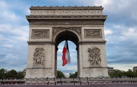 The Triumphal Arch decorated with French flag, Paris, France Standard-Bild