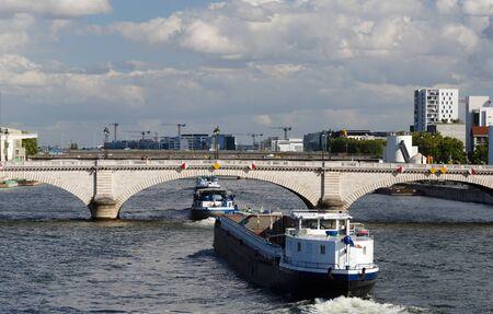 The Tolbiac bridge , Seine river and barges, Paris, France. 写真素材