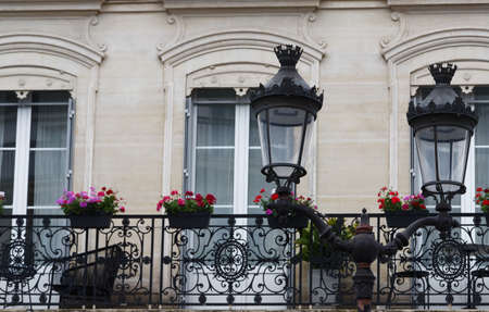 Old French house with traditional balconies and windows. Paris.