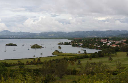 The landscape view over the beautiful Tois Ilets bay, its gorgeous nature, hills, forest, Caribbean sea , French West Indies. Zdjęcie Seryjne