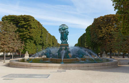 A beautiful fountain called Observatory fountain in the southern part of Luxembourg Gardens. Fountain was erected in 1874. Paris.