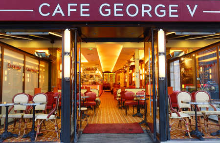 The traditional French Cafe George V located on the famous Avenue des Champs Elysees in Paris. France.