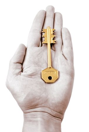Outstretched palm holding a house key