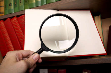 Magnifying glass and the book Stok Fotoğraf
