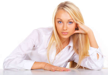 Beautiful girl the blonde On the workplace