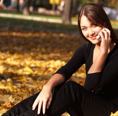 attractive young woman calling by cellular phone Stok Fotoğraf