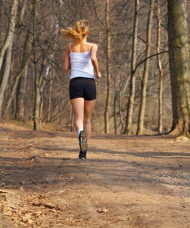 The sports girl runs in park
