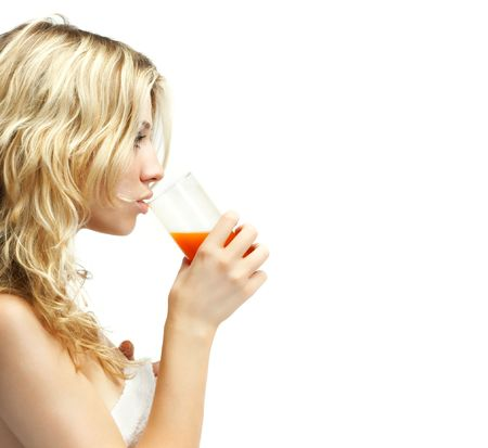 Beautiful young woman drinking orange juice