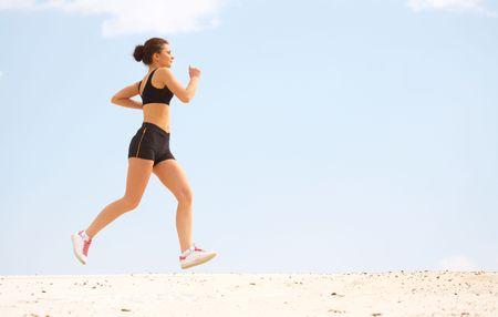 The girl runs on sand