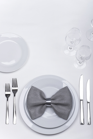Festive table set with plates, napkin, forks and knives photo