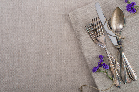 Vintage silverware with flowers photo