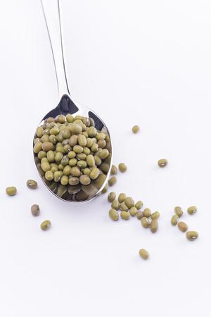 golden bean: Mung bean ingredient in spoon for asian dish