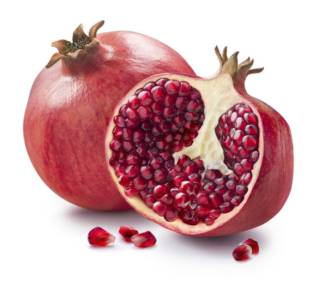 pomegranate juice: Whole, half and seeds of pomegranate isolated on white background for package design Stock Photo