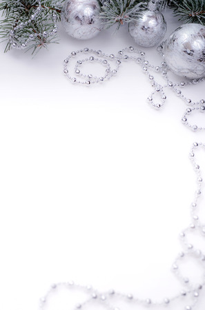 New year white table with snow fur tree and silver ball decoration Standard-Bild